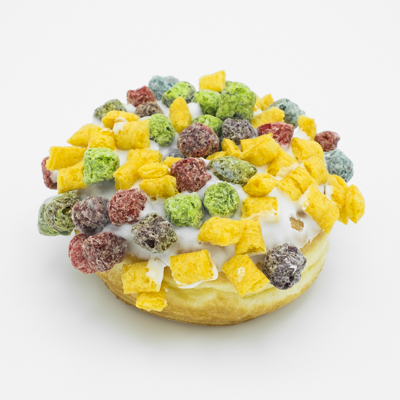 A raised yeast doughnut with vanilla frosting and Captain Crunch on top.