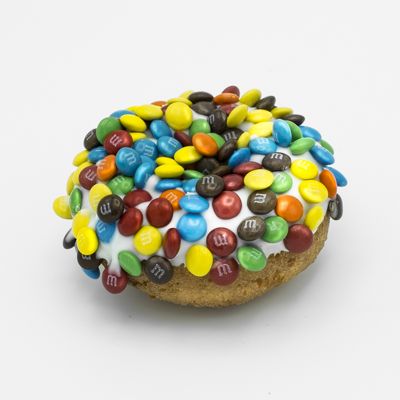 Plain cake doughnut with vanilla frosting and covered with mini M&Ms