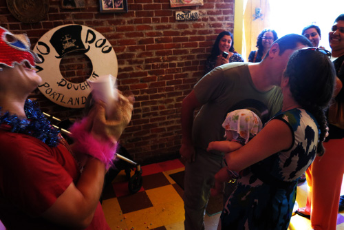 Couple kissing after Vow Renewal Re-do Your I Do ceremony at Voodoo Doughnut