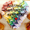 "Heart Shaped Doughnut with multi-colored icing and the words ""And they lived happily ever after"""