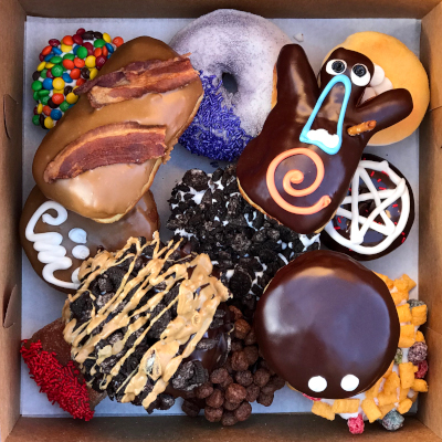 Fryer Flyer Dozen Doughnuts box from above showing selection of doughnuts
