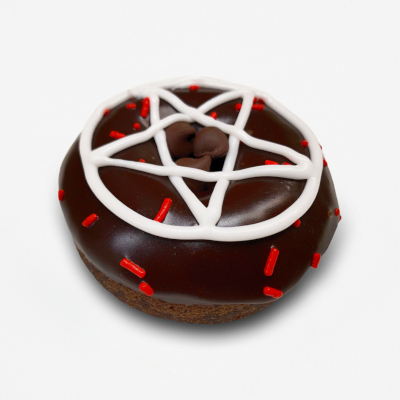 Chocolate cake doughnut with chocolate frosting a white frosting pentagram, a few red sprinkles